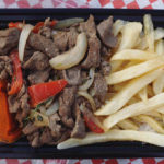 The Red Food Truck menu - lomo saltado with fries