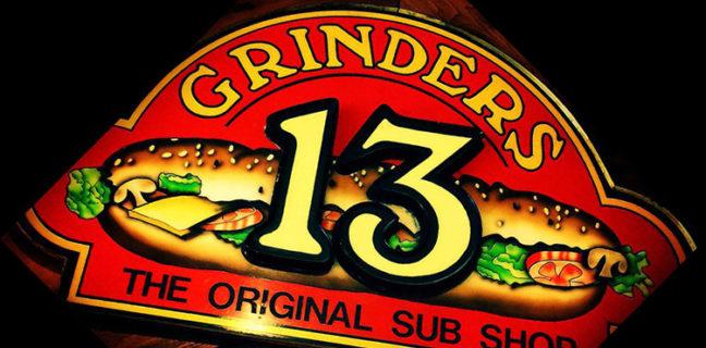 Grinders 13 sign. Credit Grinders